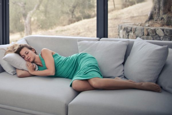 woman sleeping on sofa with throw pillows 989088 600x400 - Moms Need To Relax Too!